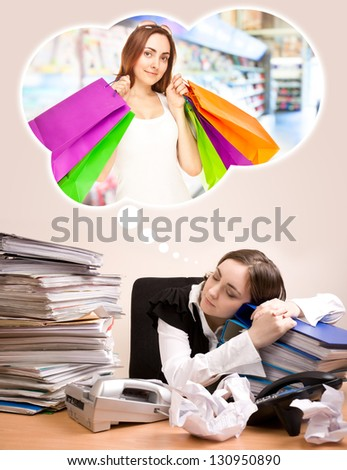 Young secretary with a lot of folders sleeping and dreaming of shopping - stock photo