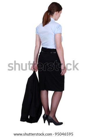 young secretary with jacket trailing behind her - stock photo