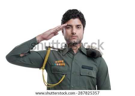 Young security guard saluting over white background