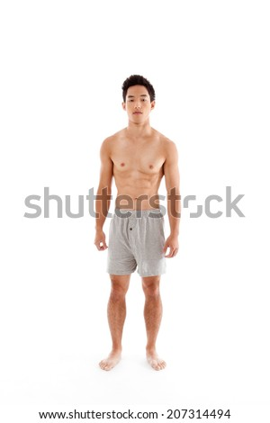 Young seminude Handsome Asian Chinese man in boxers underwear
