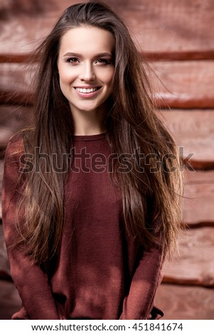 Young sensual & beauty girl in blue dress pose against grunge wooden background.