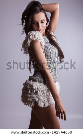 Young sensual & beauty woman in a fashionable dress.