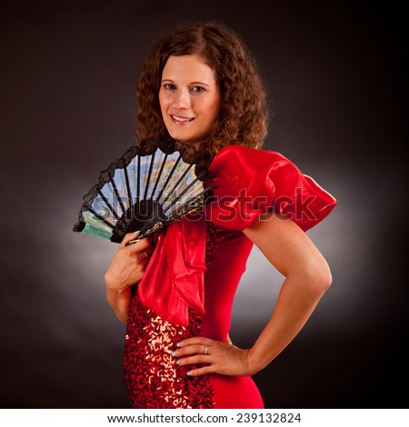 Young sensual brunette  in studio wearing french cancan dress - stock photo