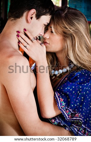 young sensual couple, outdoor shot - stock photo