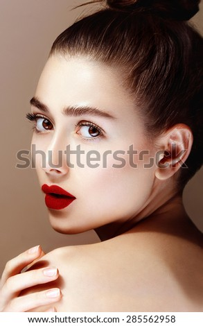 Young sensual girl with bright red lips. Natural makeup, perfect shiny skin.