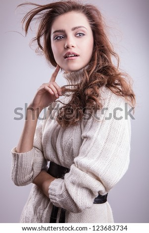 Young sensual model girl pose in studio.