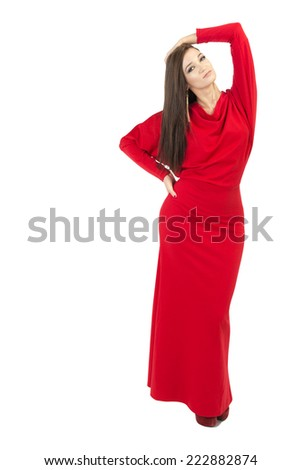 Young sensual woman in a long red dress, white background - stock photo