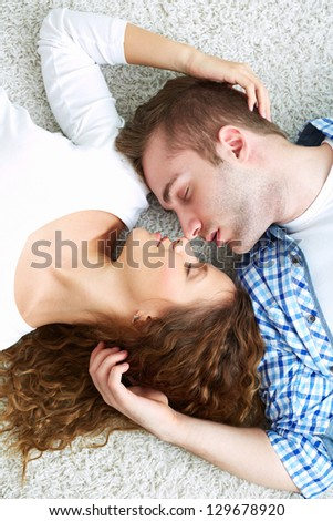 Young serene couple sleeping together - stock photo