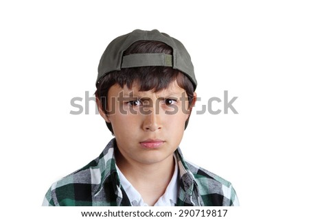 Young serious boy in green cap
