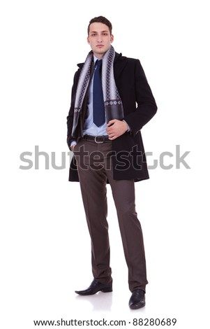 young serious business man standing on a white background - stock photo
