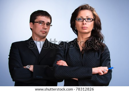 Young serious business woman and business man - stock photo