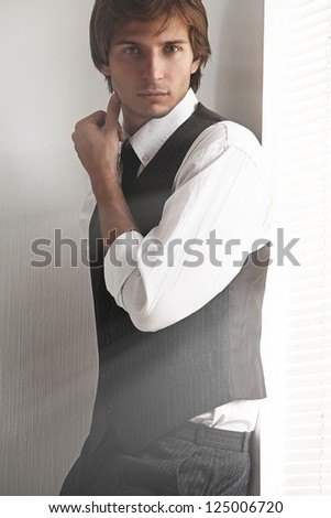 Young serious businessman near the window - stock photo