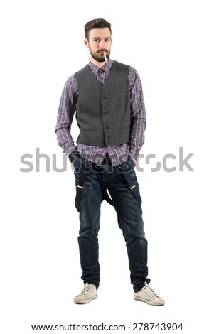 Young serious hipster looking at camera with cigarette in his mouth. Full body length portrait isolated over white background.  - stock photo