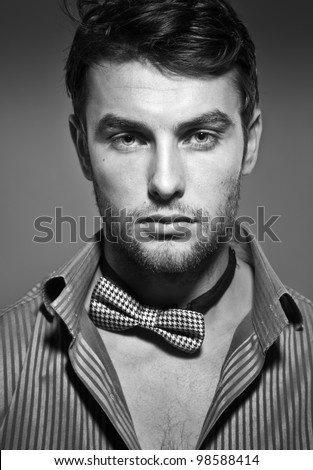 young serious man, close up, black and white photo - stock photo