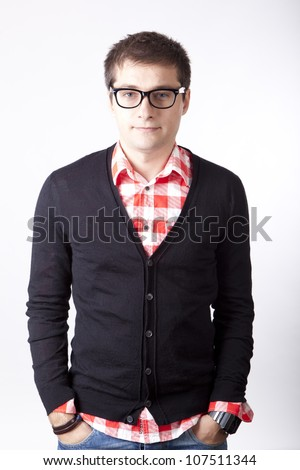 Young serious man with glasses.