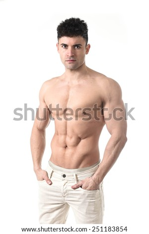 young sexy and attractive man with naked torso and ripped six pack abdomen posing cool in fashion model macho style and bodybuilding and fit body concept  - stock photo