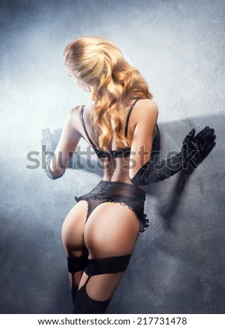 Young, sexy and beautiful blond girl in erotic lingerie.  - stock photo