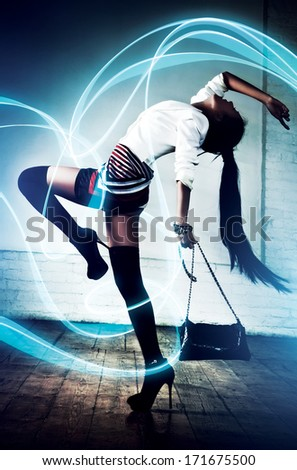 Young sexy asian woman fashion. With special lightning effect.