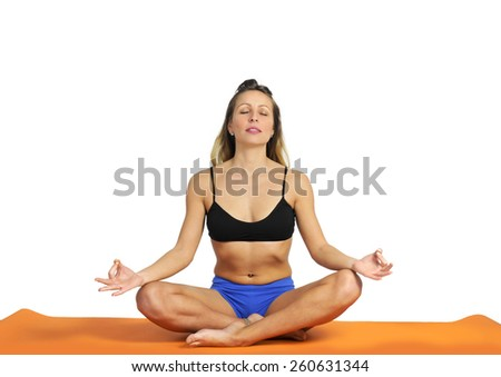 young sexy attractive fit woman at gym doing yoga exercise and position sitting on mat in meditation and relax after training workout isolated on white background - stock photo