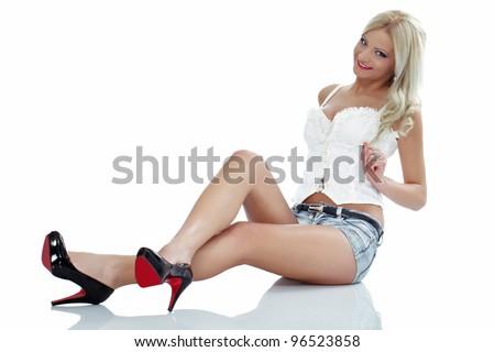 Young sexy blond with long legs, provocative posing - stock photo