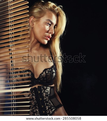 young sexy blond  woman in black lingerie - stock photo