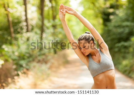 Young sexy blonde woman is doing stretching exercises  - stock photo