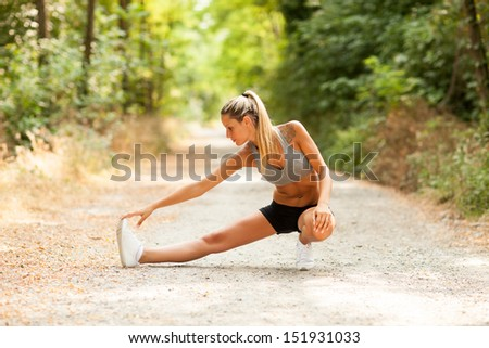 Young sexy blonde woman is doing stretching exercises