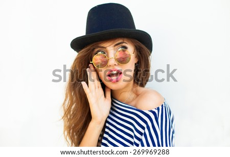 Young sexy blonde woman posing in the white wall, wearing  frock, swag hat mirrored sunglasses and bright make up,show emotions, Lifestyle portrait bright toned colors.Cool hat,Reflecting Sunglasses  - stock photo