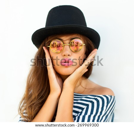 Young sexy blonde woman posing in the white wall, wearing  frock, swag hat mirrored sunglasses and bright make up,show emotions, Lifestyle portrait bright toned colors. - stock photo