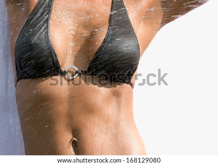 Young sexy brunette in black swimsuit - stock photo