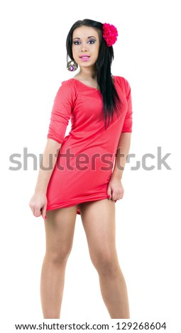 Young sexy brunette in red dress and hands around the body - stock photo