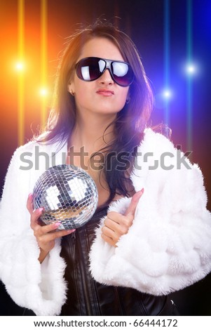 Young sexy brunette in the disco club - stock photo