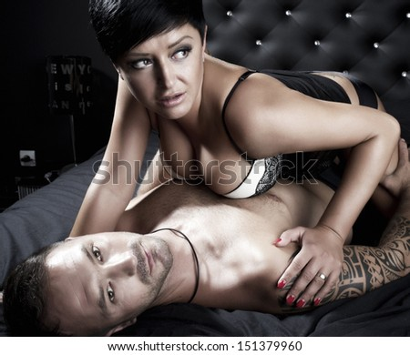 Young sexy couple in a bed  - stock photo