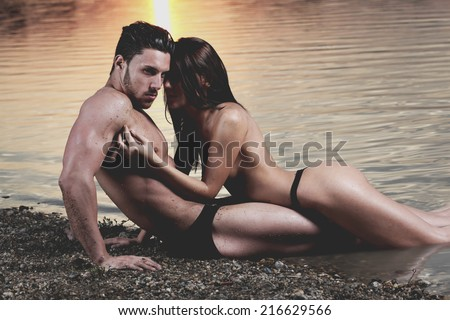 Naked sexy couple beach