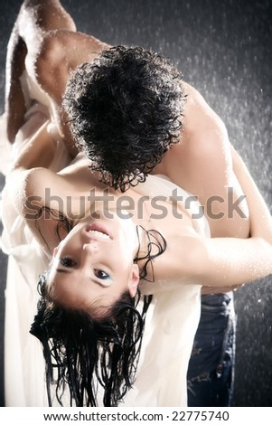 Young sexy couple passion. Water studio photo. - stock photo