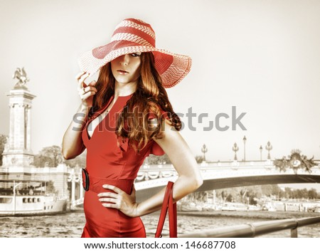 Young sexy fashionable woman wearing red hat and dress - stock photo