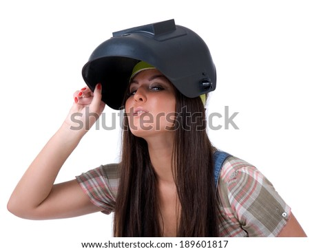 Young sexy female dressed in jeans and weld helmet. White isolated background. Welding mask.