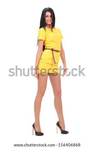 young sexy girl in a yellow dress - stock photo