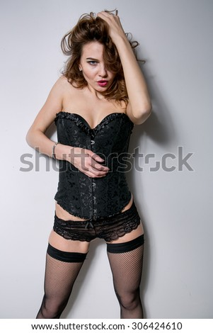 young sexy girl in erotic lingerie studio