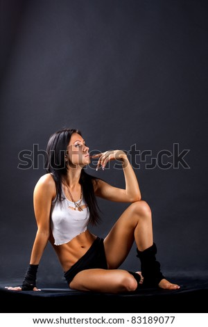 Young sexy girl over black background
