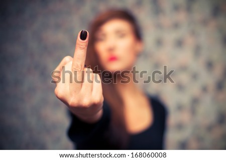 Young sexy girl showing middle finger gesture. - stock photo