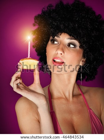 young sexy girl with small sweet cake on  color background
