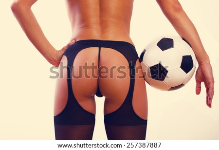 Young sexy girl with soccer ball