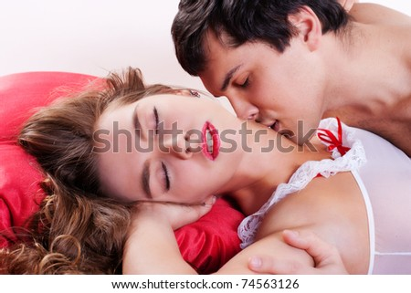 Young sexy heterosexual couple making love in bed