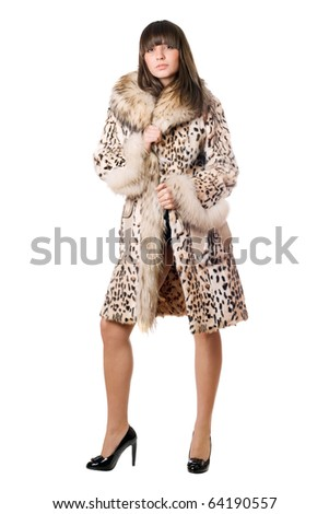 Young sexy lady in leopard coat. Isolated on white
