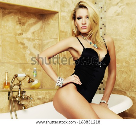 Young sexy lingerie woman posing - stock photo