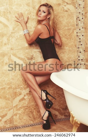 Young sexy lingerie woman posing, sensual blond - stock photo