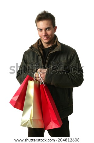 Young sexy man wearing winter clothes with shopping bags isolated on white - stock photo