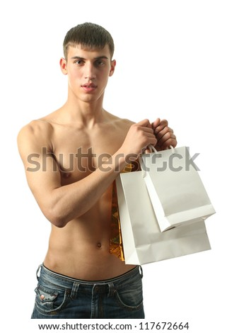 Young sexy man with copy space shopping bags isolated on white - stock photo