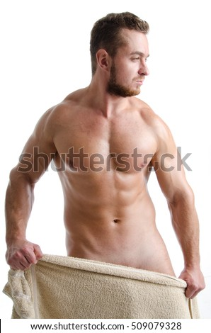 Young sexy man wrapped in a towel.